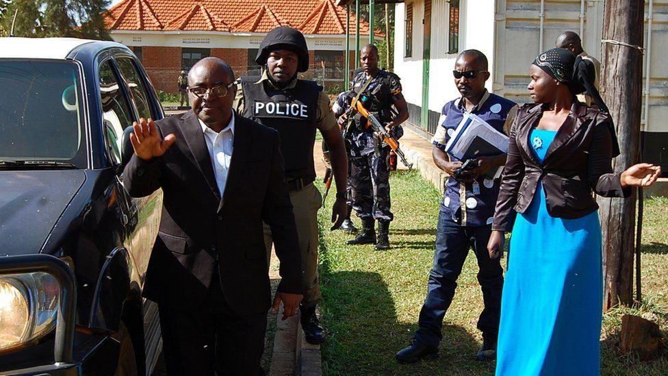 Charles Mumbere, king of Rwenzururu waves outside court.