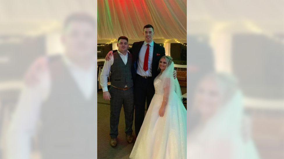 Adam Beard with bride and groom