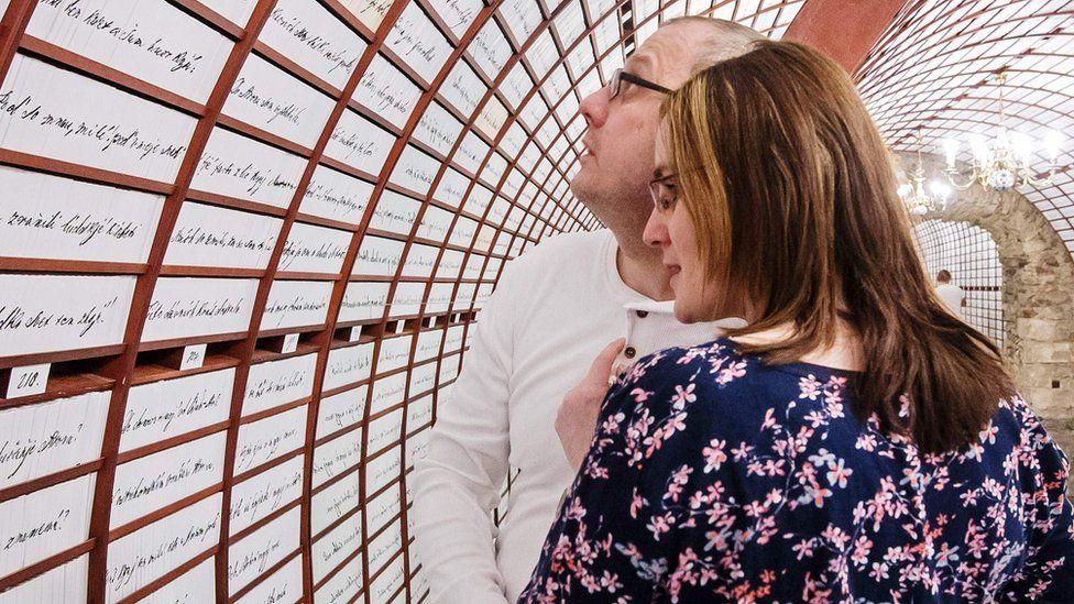 A couple in Banska Stiavnica 'love bank'