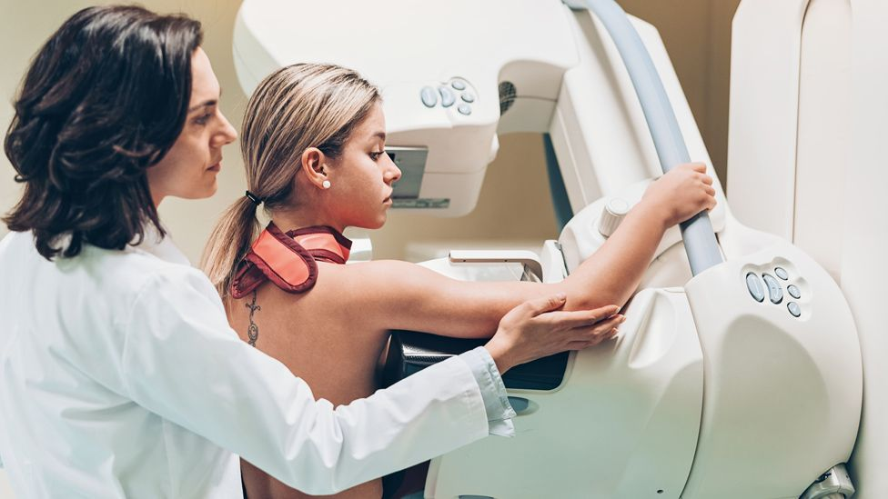 A doctor and patient at a breast screening
