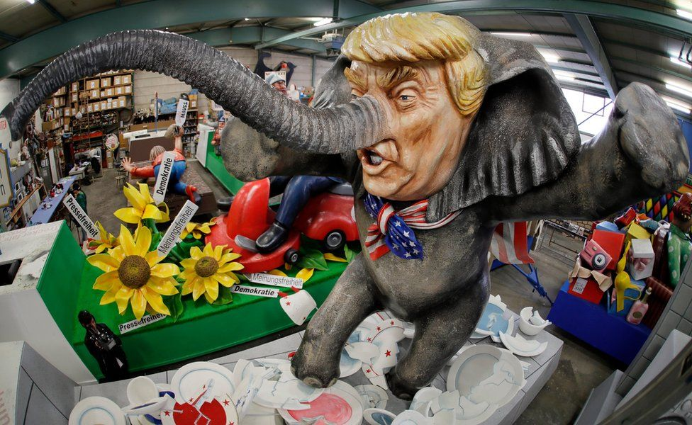 """A carnival float titled """"Trump-el-tier"""", depicting the new US President as an """"Elephant in a China shop"""", in Mainz, Germany, 21 February 2017."""