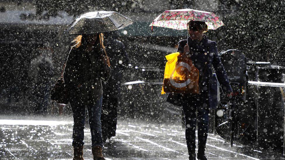 People walking in heavy rain in Stockholm