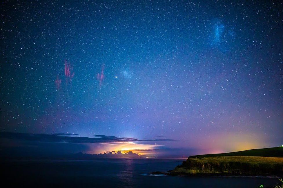 A panoramic image showing sprites and the Aurora Australis