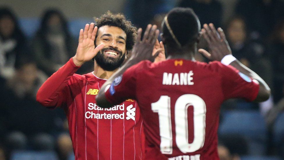 Liverpool's Egyptian midfielder Mohamed Salah (L) celebrates with Liverpool's Senegalese striker Sadio Mane (R) after scoring a goal during the UEFA Champions League Group E football match between (KRC) Genk and Liverpool on October 23, 2019 at the Luminus Arena in Genk.