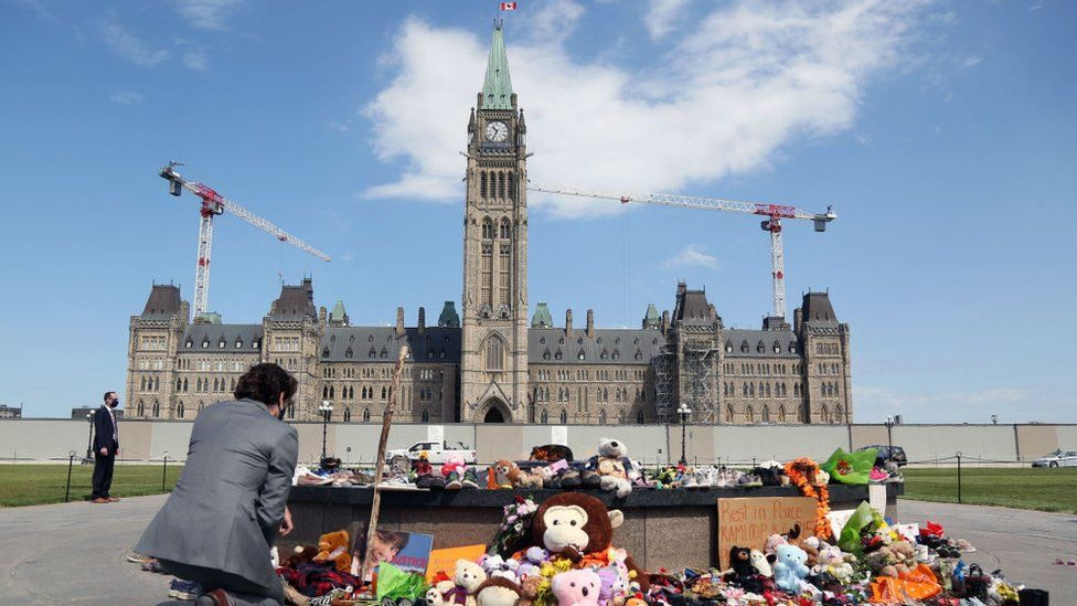 Canadian Prime Minister Justin Trudeau visits the makeshift memorial erected in honor of the 215 indigenous children remains found at a boarding school in British Columbia, on Parliament Hill June 1, 2021 in Ottawa