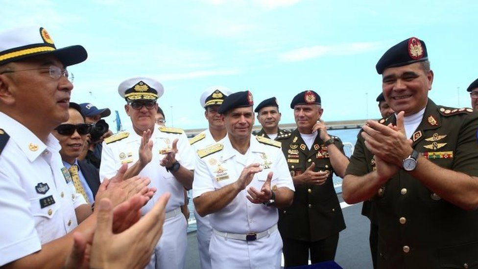 Venezuela's Defence Minister Vladimir Padrino Lopez (R) attends the arrival ceremony of the China's People's Liberation Army (PLA) Navy hospital ship Peace Ark at the port in La Guaira, Venezuela September 22, 2018.