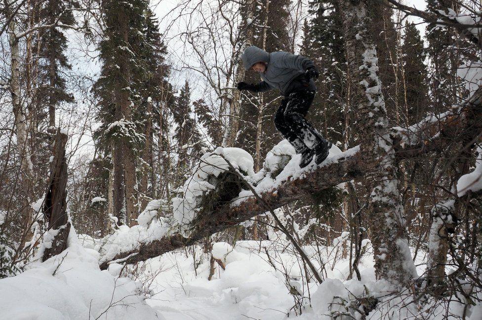 Sky jumps off a log