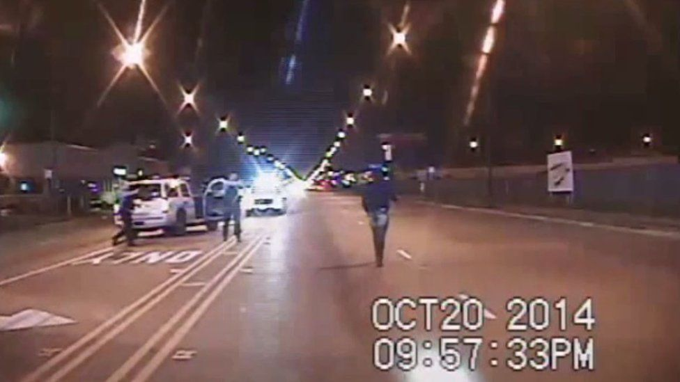 Laquan McDonald, right, in the dash camera footage that was eventually released