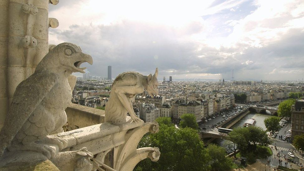 """Notre-Dame """"gargoyles"""" look out over the city"""
