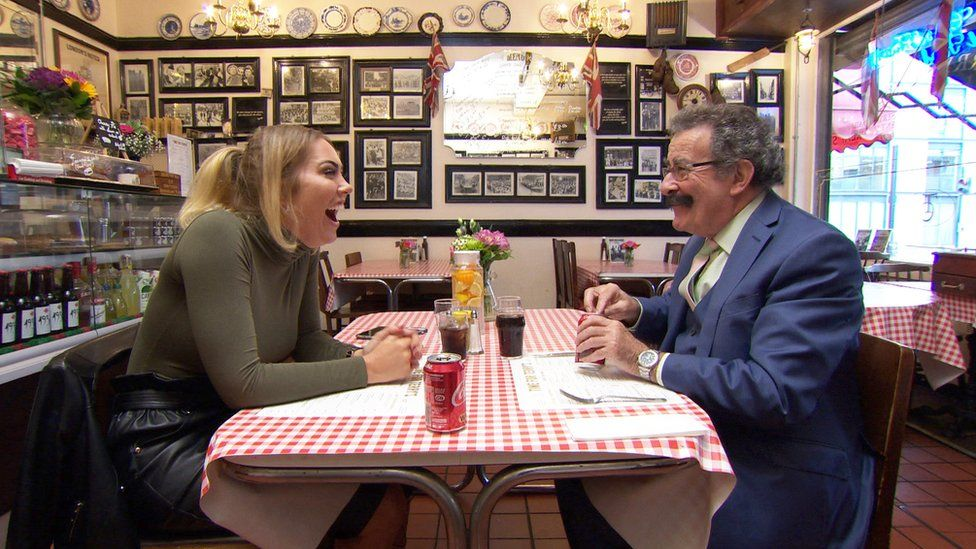 Aisleyne and Prof Winston laughing at the table
