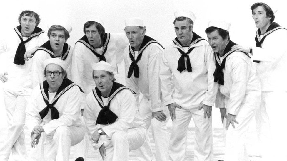 back row l-r Michael Aspel, Philip Jenkinson, Barry Norman, Frank Bough,Eddie Waring, Richard Baker and Richard Whitmore front row l-r Eric Morecambe and Ernie Wise in 'The Morecambe and Wise Christmas Show'