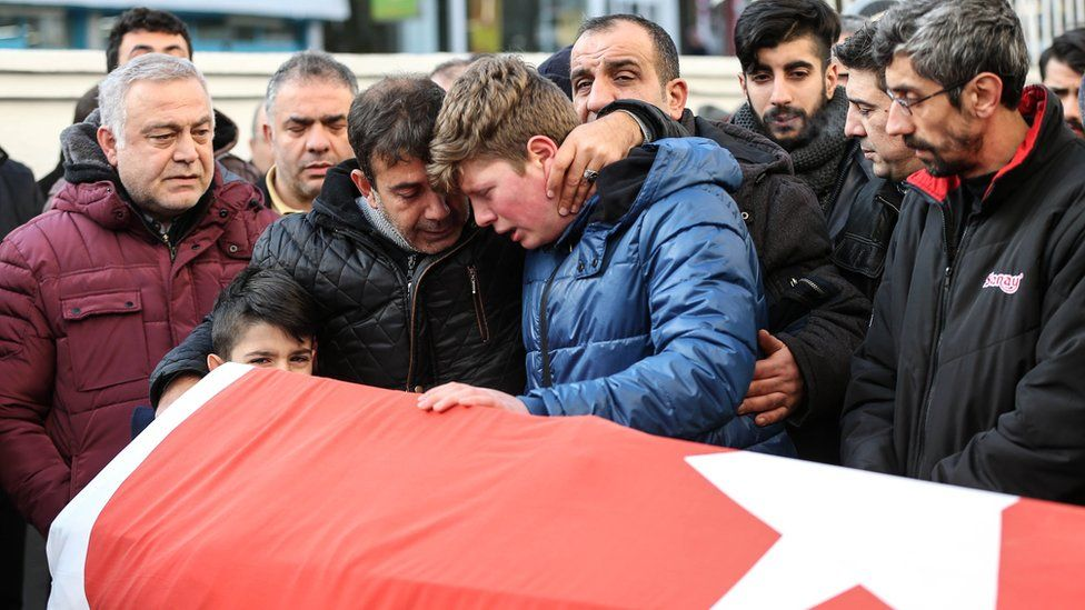 Relatives and friends mourn at a coffin during the funeral of Ayhan Arik, one of the 39 victims of the gun attack on the Reina, a popular night club in Istanbul near by the Bosphorus shores, in Istanbul, January 1, 2017, Turkey.