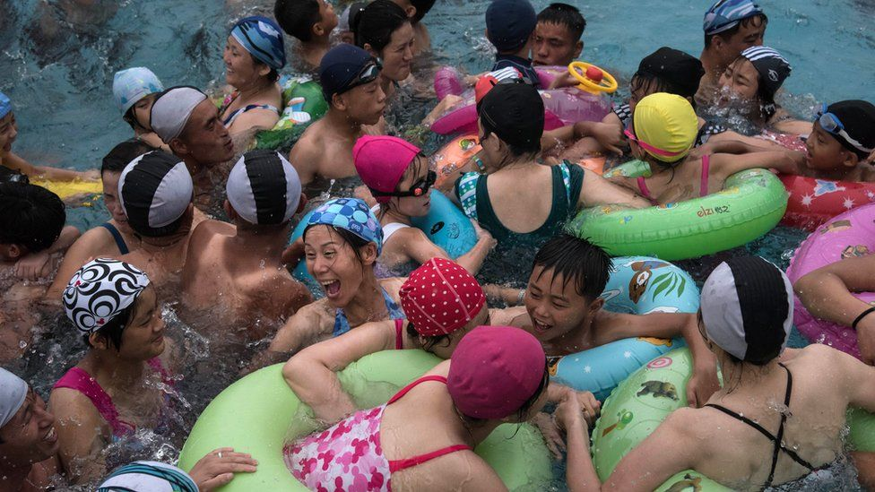 Swimmers gather in a wave pool at a water park in a leisure complex in Pyongyang on July 21, 2017