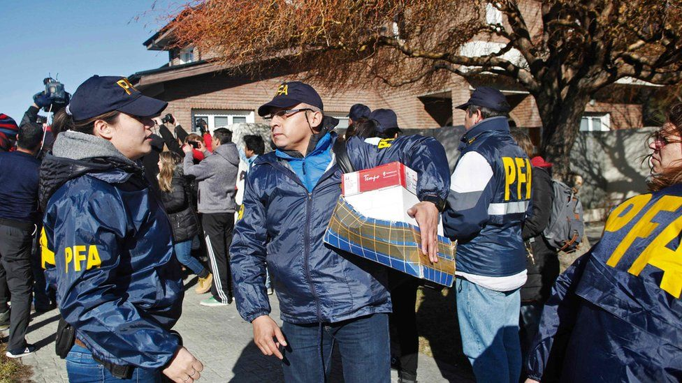 The Argentine Federal Police (PFA) takes part in a raid at the house of former Argentine President and current senator Cristina Fernandez de Kirchner in Rio Gallegos, Santa Cruz Province, in southern Argentina,