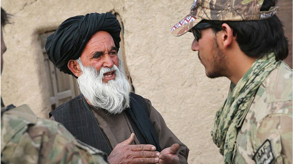 An Afghan interpreter with the U.S. Army's 4th squadron 2d Cavalry Regiment helps to question a villager