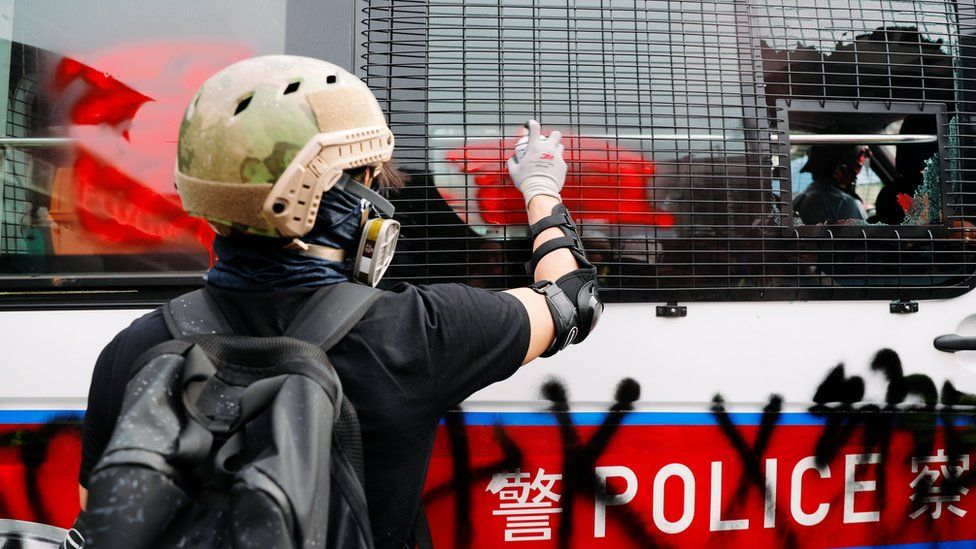 A demonstrator paints on a police vehicle during a protest against the Yuen Long attacks in Yuen Long, New Territories, Hong Kong, China July 27, 2019