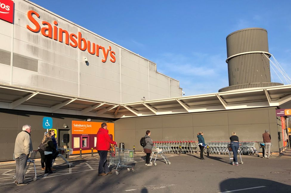 Shoppers observed social distancing as they queue outside Sainsbury's