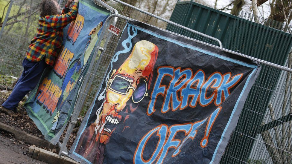 """A poster that reads """"frack off"""""""