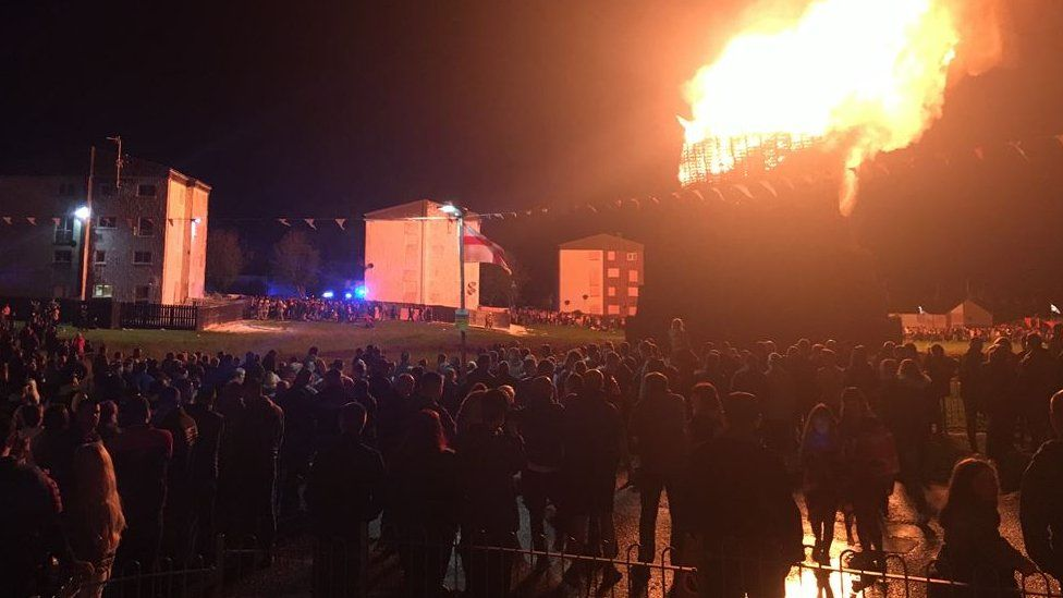 A large crowd of people watch as the Drumilly Green bonfire was lit on Wednesday night