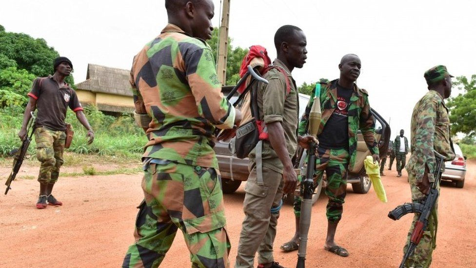 """Mutinous soldiers stand inside a military camp in the Ivory Coast""""s central second city Bouake, on May 15, 2017."""