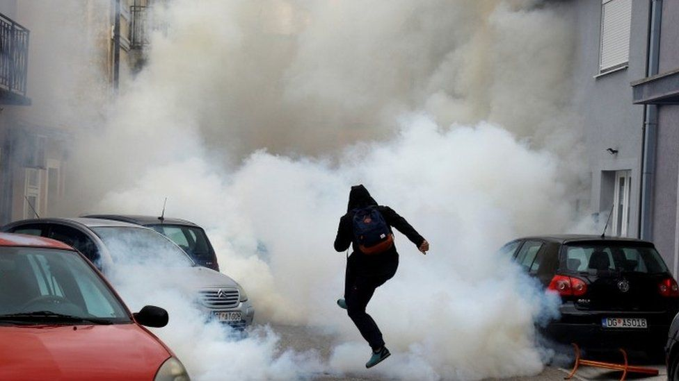 A protester is enveloped in tear gas in Montenegro