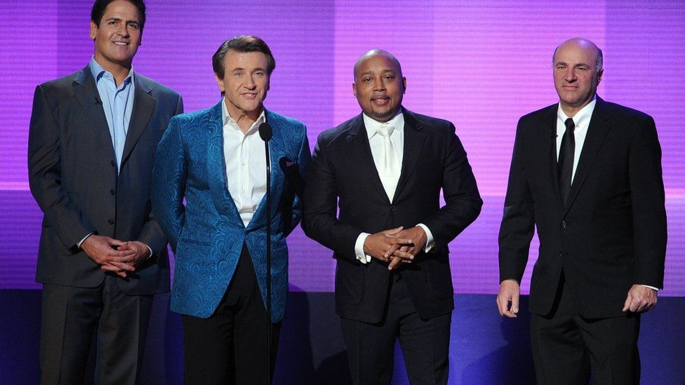 TV personalities Mark Cuban, Robert Herjavec, Daymond John, and Kevin O'Leary speak onstage during the 2013 American Music Awards at Nokia Theatre L.A. Live on November 24, 2013 in Los Angeles, California.