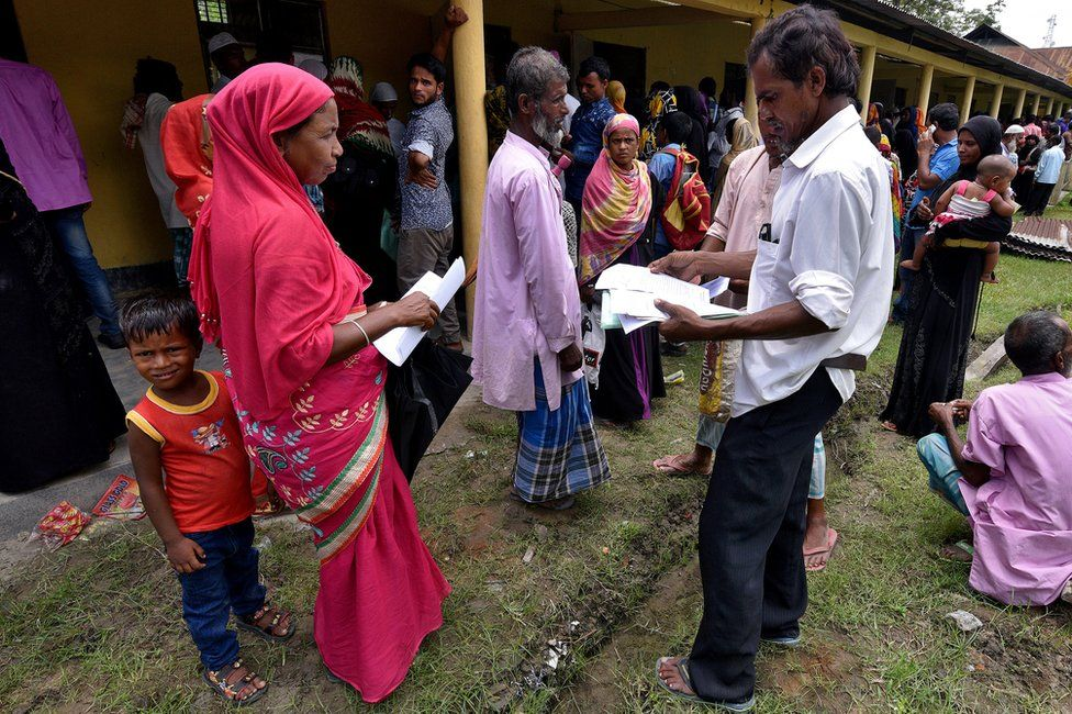 Villagers in Assam wait outside the National Register of Citizens (NRC) centre to get their documents verified by government officials.