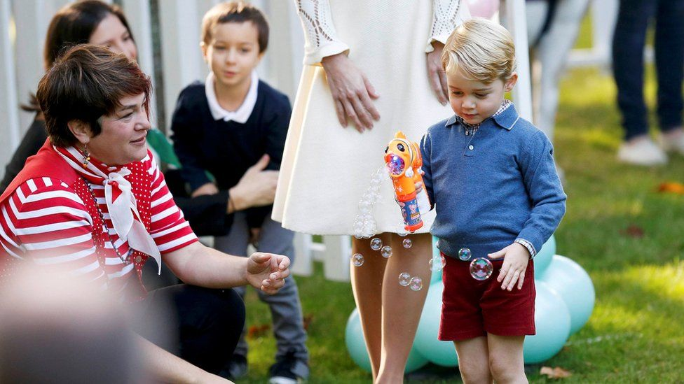 Prince George plays with a bubble gun at Government House