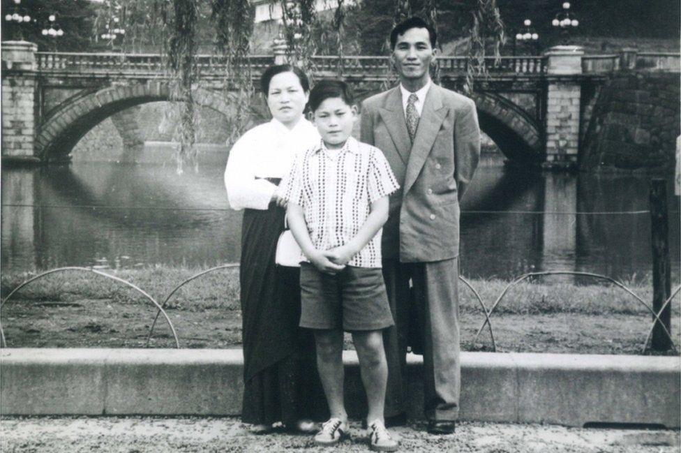 An undated handout photo made available by Samsung Group on 25 October 2020 shows Chairman Lee Kun-hee (C) as a child together with his parents, in South Korea