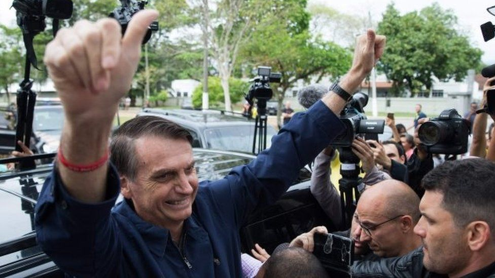 Jair Bolsonaro gives his thumbs up after casting his vote at Villa Militar,