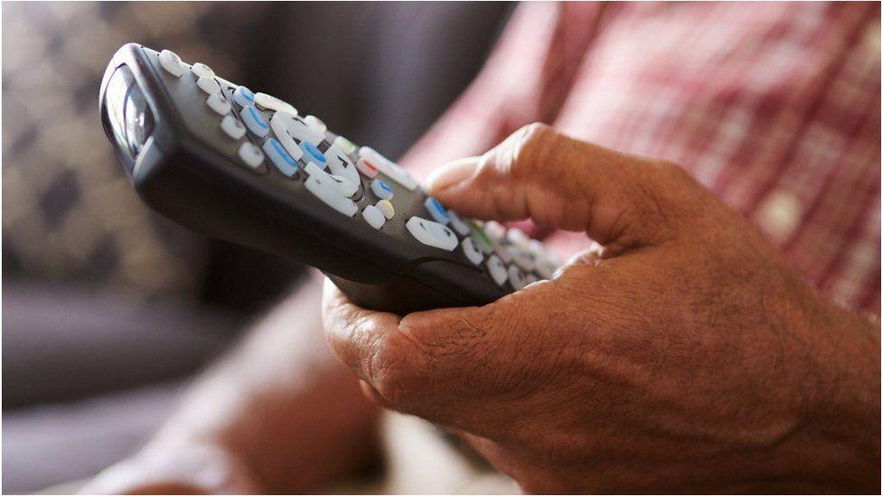 Person holding remote control