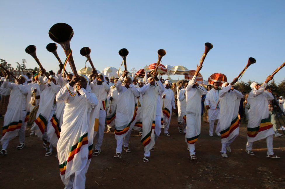 Religious trumpeters