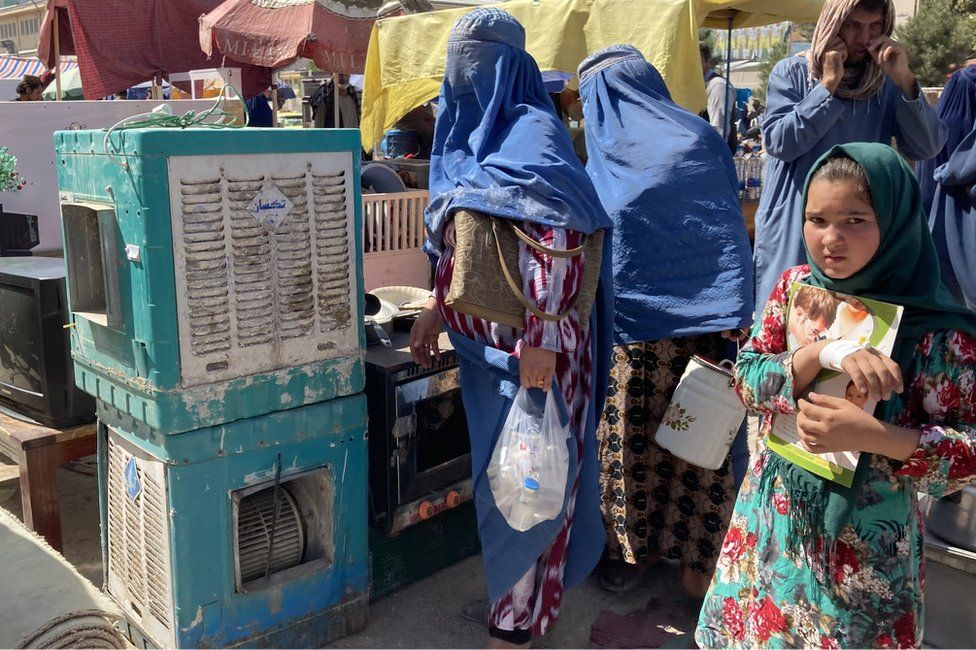 A girl at second hand market in Mazar-i-Sharif in Afghanistan