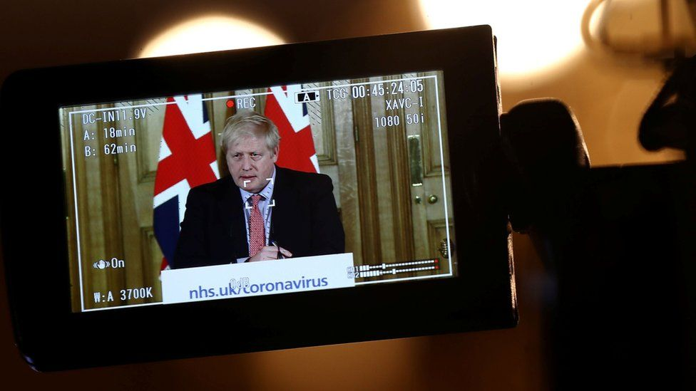 A camera films the Prime Minister Boris Johnson making a speech