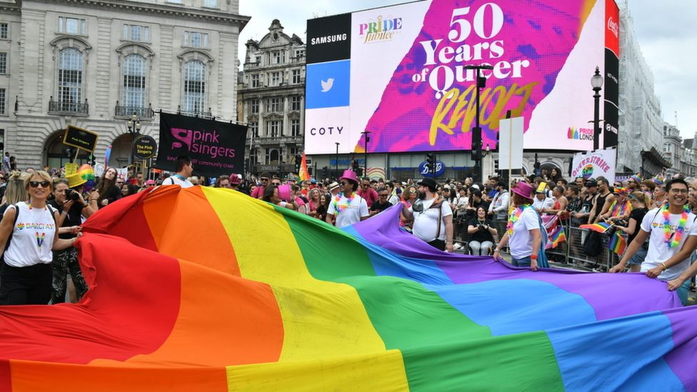 Celebrations during the 2019 Pride parade as the rainbow flag is carried through London's Piccadilly Circus