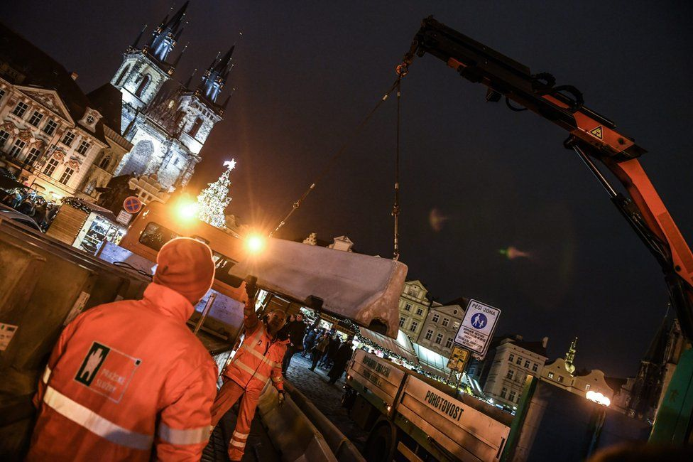 Municipal workers install roadblocks that will be used in new security measures at the entrance to the Old Town Square Christmas market in Prague, Czech republic, 21 December