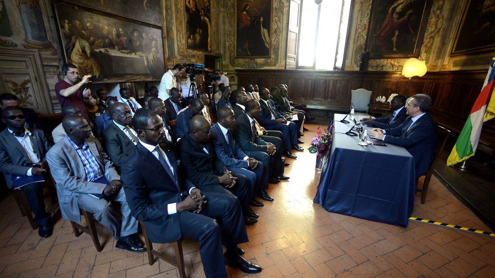 Sant'Egidio President Marco Impagliazzo (R) addresses a delegation from Central African Republic on June 19, 2017 inside the Sant'Egidio community church in Rome