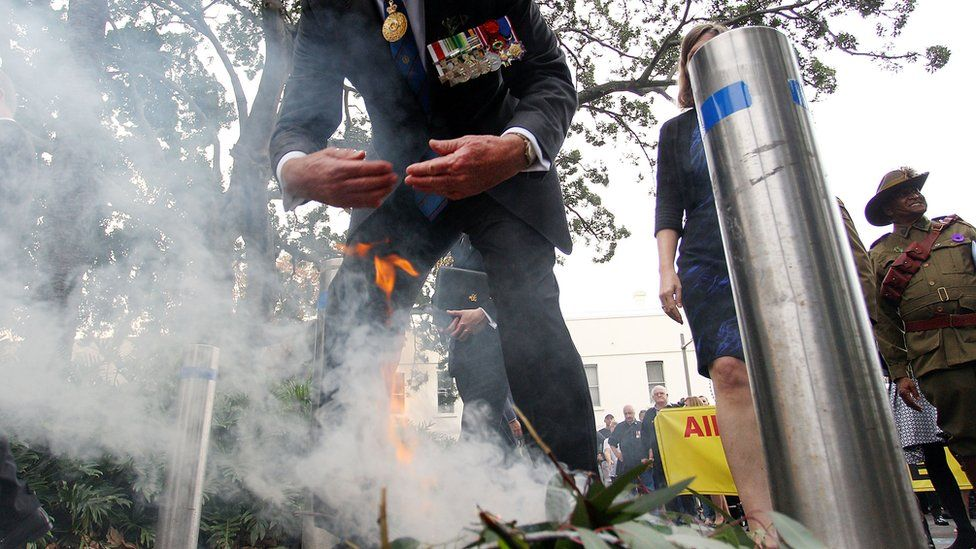 A man partakes in a traditional smoke ceremony at an Anzac Day service in Sydney in 2017