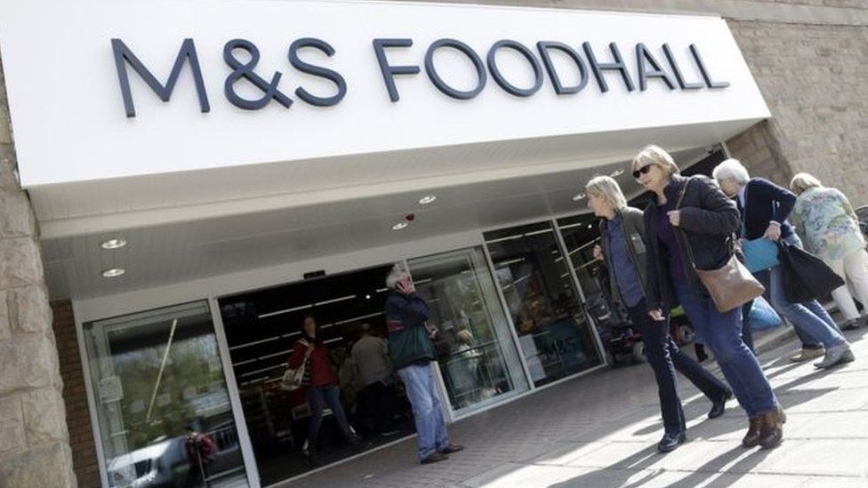 Shoppers outside an M&S Foodhall store
