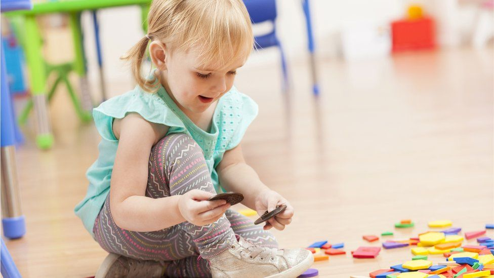 A girl plays with toys
