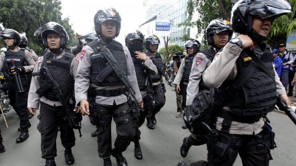 Police on patrol in Jakarta
