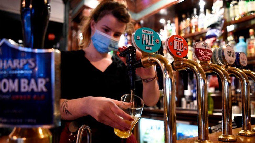 Pub worker wearing face mask