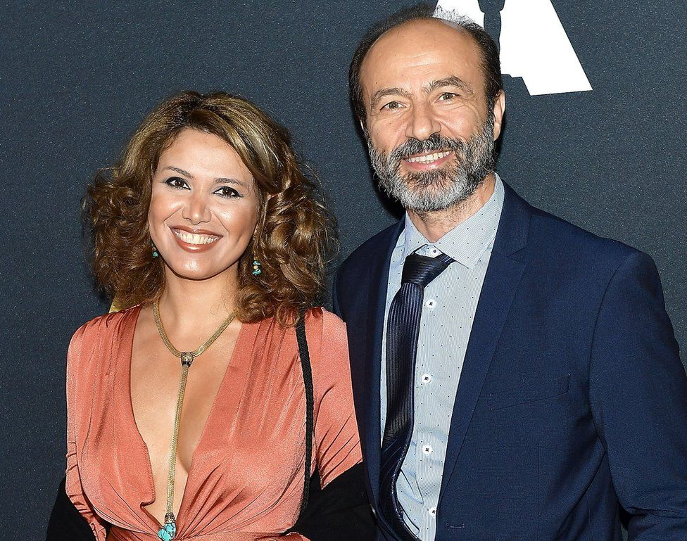 """Jihad """"Jay"""" Abdo and his wife Fadia Afashe smile at an event in California in 2017"""