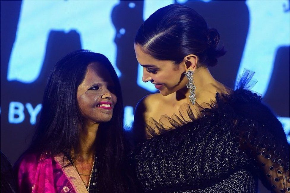 """Actress and producer Deepika Padukone (R) poses with acid attack survivor Laxmi Agarwal (L) during the launch of the title track for the upcoming Hindi film Chhapaak, which tells Agarwal""""s story, in Mumbai on January 3, 2020."""