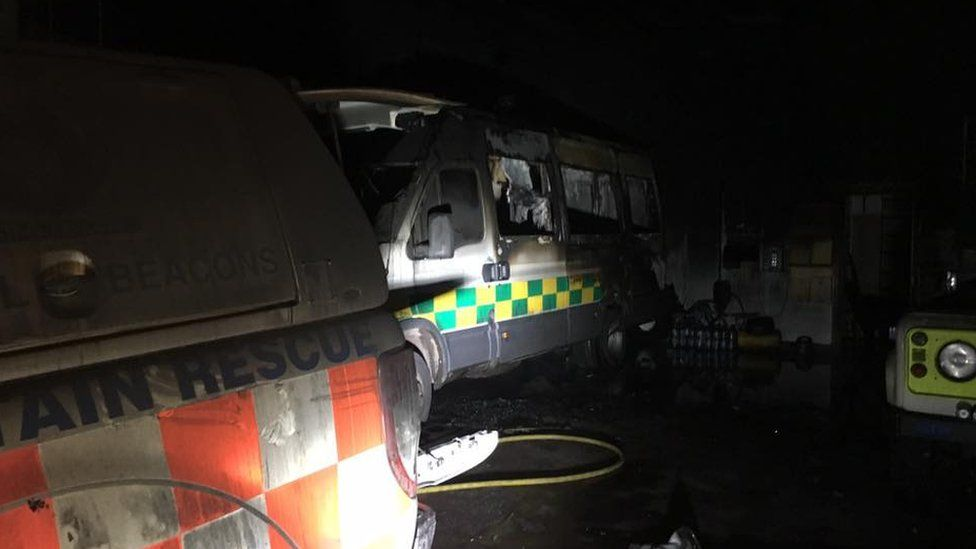 The team's three vehicles were damaged in the fire