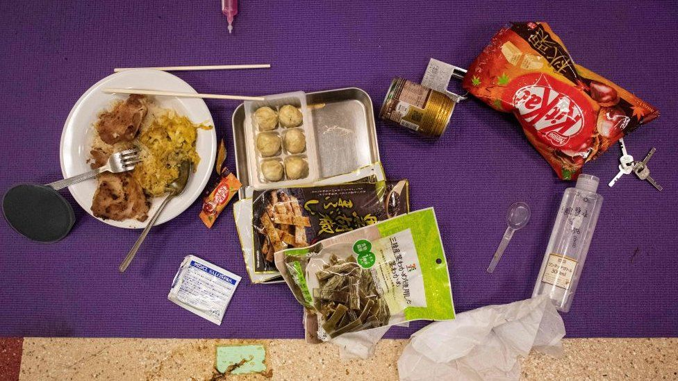 Food left over by a protester is seen on a mat on the floor inside the Hong Kong Polytechnic University