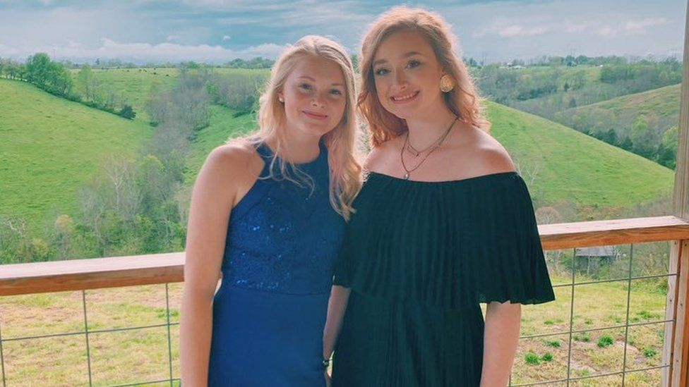Isabella and her sister in their prom dresses