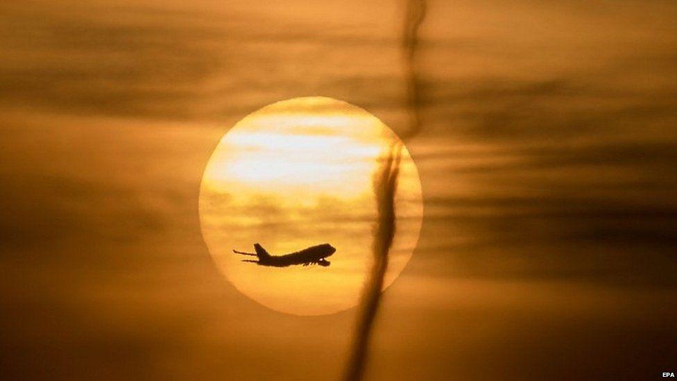 Airplane against a setting sun