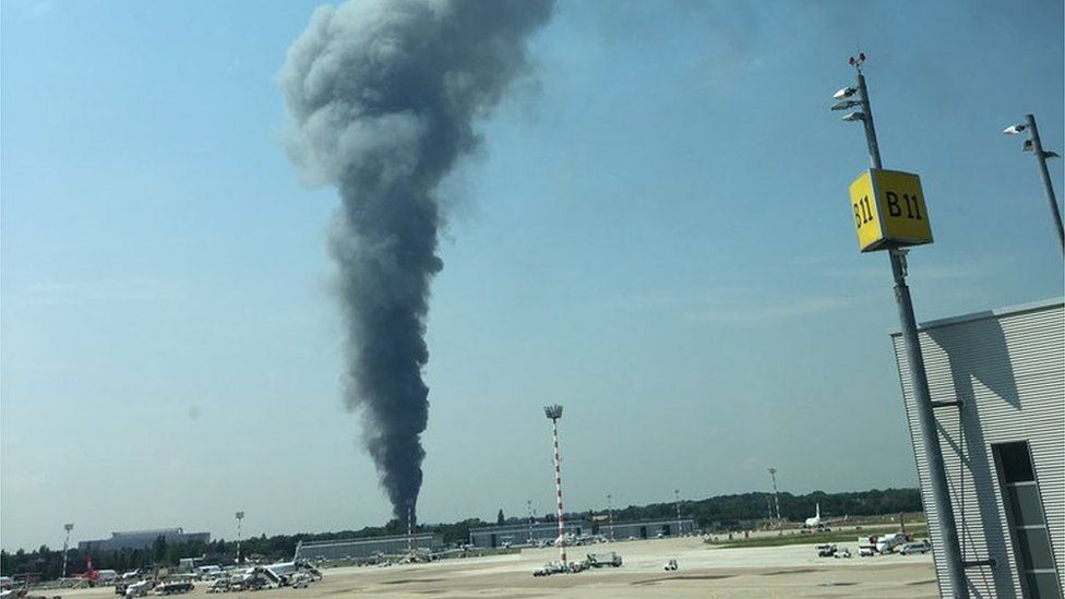 A fire raging at Duesseldorf convention centre is visible from the airport as captured by witness Ben Smith on 7 June 2016