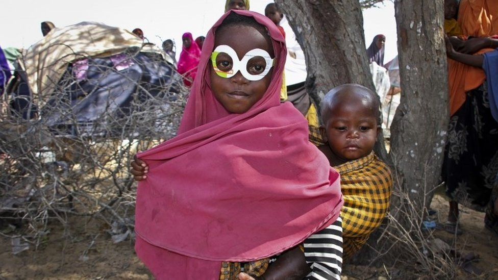 This young Somali girl thought she would impress her brother with her cut-out glasses, made from a medicine packet.